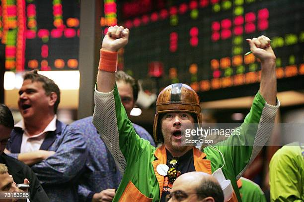 Wearing a vintage football helmet Greg O'Leary signals offers in the wheat pit at the Chicago Board of Trade February 2 2007 in Chicago Illinois Many...