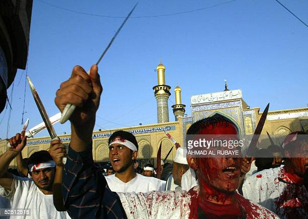 Wearing a white shroud and holding swords Shiite Muslim pilgrims take part in self flagellation during lamentation ceremonies in the southern city of...