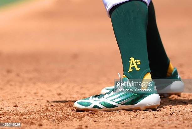 Wearing Adidas baseball cleats Billy Burns of the Oakland Athletics leads off of first base against the Kansas City Royals in the bottom of the...