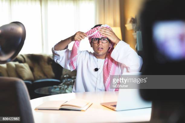 Wearing an Arabic scarf, taught by a young Emirati content creator