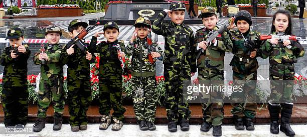 Wearing armystyle camouflage costumes little Azerbaijanis take part in a ceremony to mark the 21st anniversary of what Azerbaijan refers to as the...