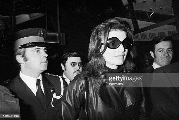 Wearing dark glasses black turtleneck sweater and black leather coat Mrs Jacqueline Kennedy Onassis leaves her plane at Charles de Gaulle Airport in...