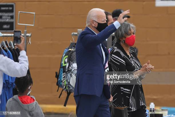 Wearing face masks to reduce the risk posed by the coronavirus, Democratic presidential nominee Joe Biden and Rep. Brenda Lawrence leave Three...