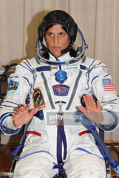 Wearing her space suits US astronaut Sunita Williams a crew member of the next expedition to the International Space Station prepares to take part in...