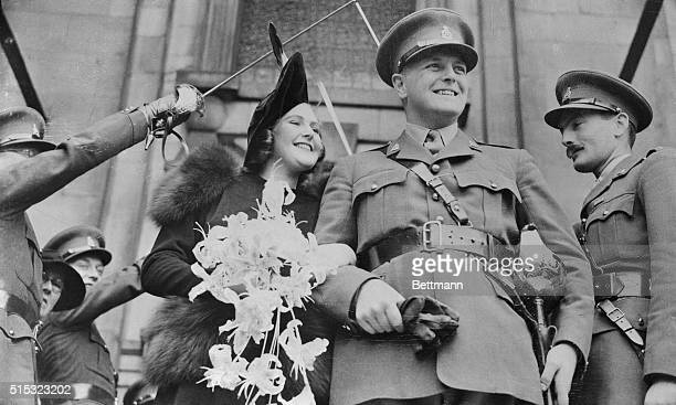 Wearing his army officer's uniform Randolph Churchill son of Winston Churchill First Lord of the British Admiralty is shown leaving St John's church...