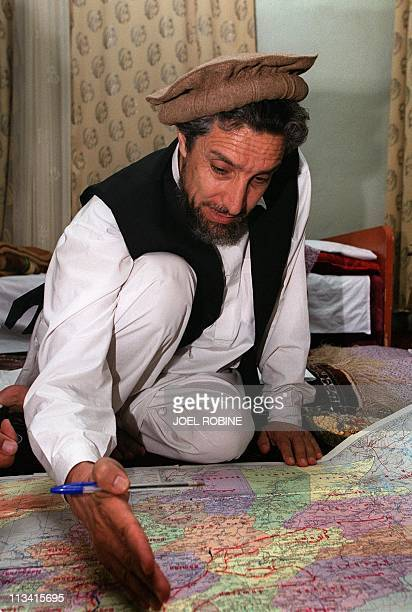 Wearing his trademark brown Afghan woollen hat the Afghan opposition's veteran military commander Ahmad Shah Masood shows 28 June 2001 the frontline...
