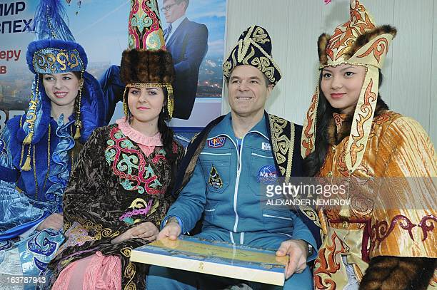 Wearing Kazakh traditional costume US astronaut Expedition 34 Commander Kevin Ford poses for a photo with Kazakh girls at the airport of Kostanay on...