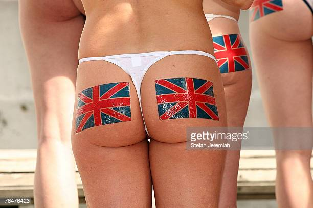 Wearing little more than fake bearskin caps Union Jacks painted on their bare backsides and holding a banner that reads Bare Skin Not Bear Skins 21...