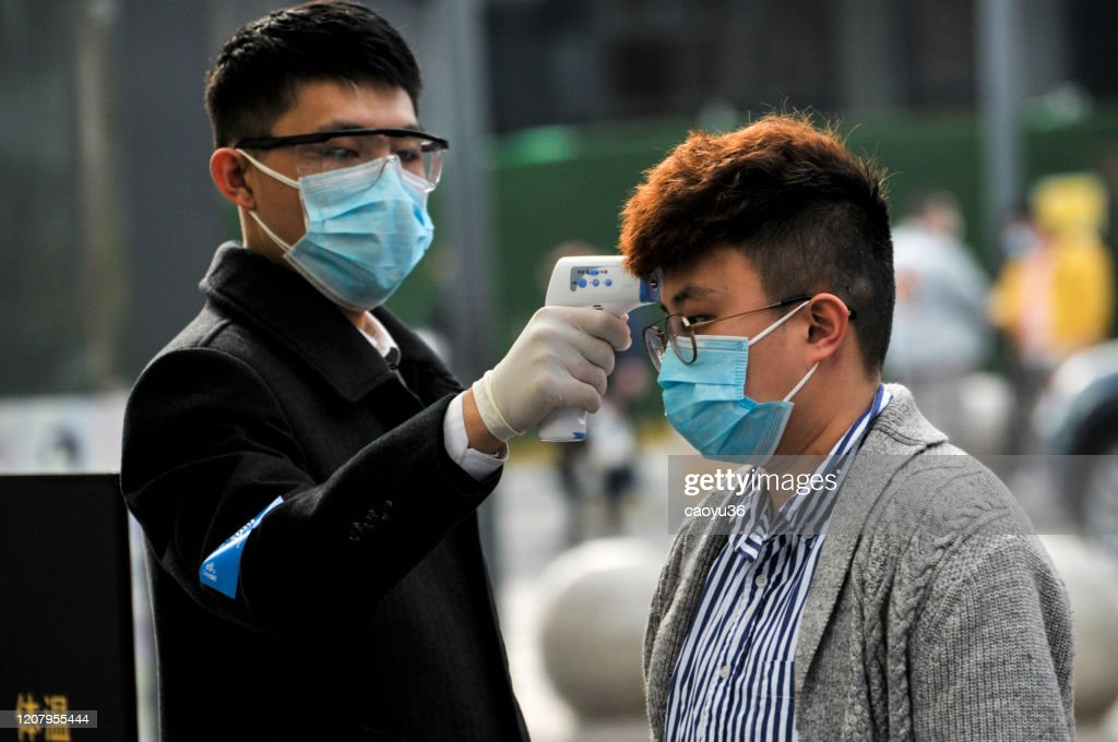 Wearing masks, people lined up for temperature checks before entering the mall 、Starbacks and hotel in Chengdu,China : Stock Photo