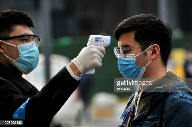 wearing masks, people lined up for temperature checks before entering the mall 、starbacks and hotel in chengdu,china - covid stock pictures, royalty-free photos & images