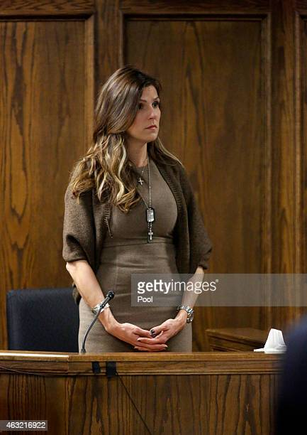 Wearing military dog tags and a cross around her neck, Taya Kyle, wife of former Navy SEAL Chris Kyle stands to wait for the jurors to enter the...