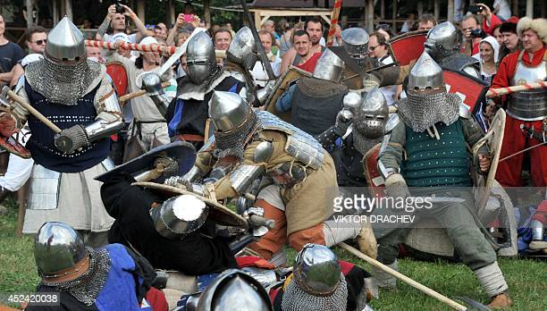 Wearing modern replicas of medieval armour military history enthusiasts from Belarus Russia and Ukraine take part in a staged battle near the village...