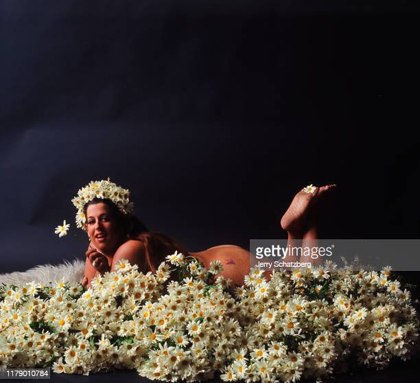 Wearing only a daisy crown on her head American singer 'Mama' Cass Elliot lies on a bed of daisies New York New York June 10 1967