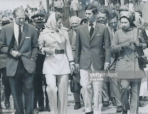 Wearing Pantsuits for protection from the blackflies Queen Elizabeth and Princess Anne walk through Fort Providence Northwest Territories with Prince...