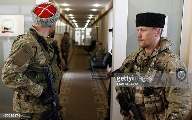 Wearing papakha traditional fur hats of Kuban cossacks proRussian rebels guard a lobby in the regional administration headquarters in Donetsk on July...