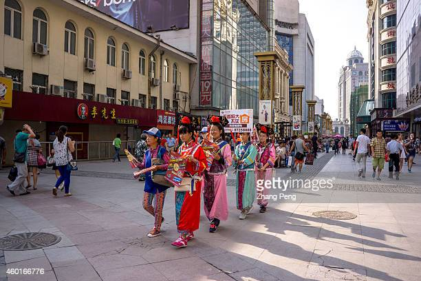 Wearing princess costume of Qing Dynasty young girls walk on a business street to promote a residential housing project On Dec 9 2014The central...