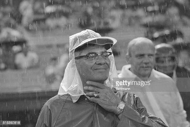 Wearing rain gear against a heavy thunderstorm, Vince Lombardi, new head coach of the Washington Redskins watches his team play the Chicago Bears in...