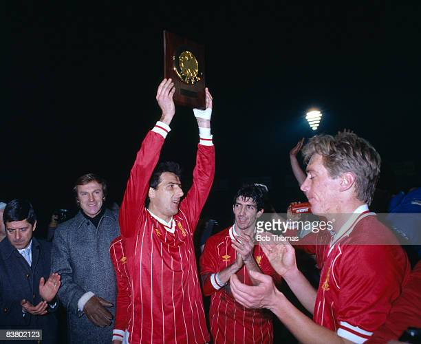 Wearing shirts exchanged with their opponents Juventus captain Gaetano Scirea Paolo Rossi and Massimo Bonini celebrate after beating Liverpool 20 in...