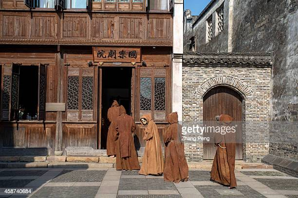 WUZHEN TONGXIANG ZHEJIANG CHINA Wearing skeleton masks French artists perform a dumb show in the front yard of an Chinese ancient architecture The...
