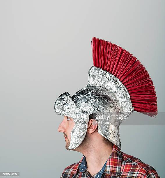 wearing spartan helmet of foil - resourceful stock pictures, royalty-free photos & images