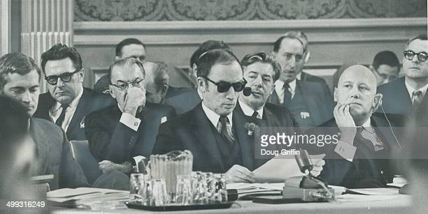 Wearing sunglasses he went home to pick up at launchtime to shield his eyes from the glare of TV lights Prime Minister Pierre Trudeau reads a...
