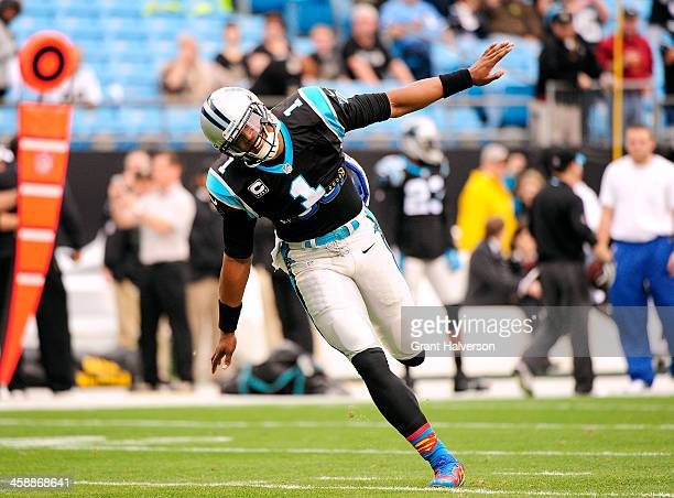 Wearing Superman socks Cam Newton of the Carolina Panthers takes the field for warmups before a game against the New Orleans Saints at Bank of...