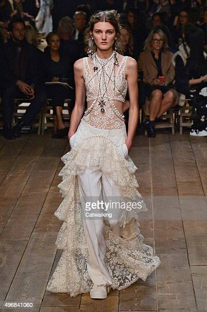 Wearing the latest lacey fabric trend, a model walks the Alexander McQueen fashion show runway at the spring summer 2016 women's ready-to-wear...