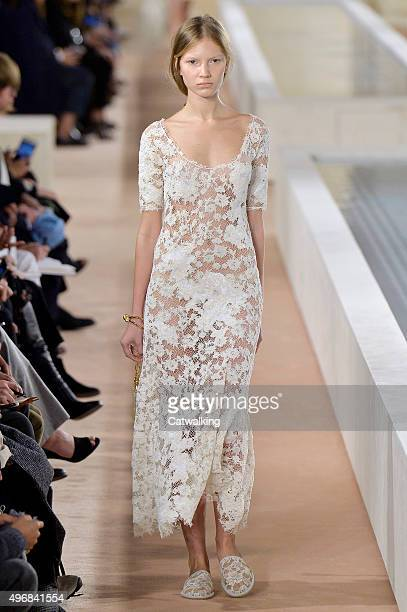Wearing the latest lacey fabric trend a model walks the Balenciaga fashion show runway at the spring summer 2016 women's readytowear fashion weeks...