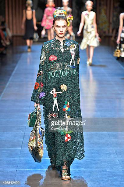 Wearing the latest lacey fabric trend a model walks the Dolce Gabbana fashion show runway at the spring summer 2016 women's readytowear fashion weeks...