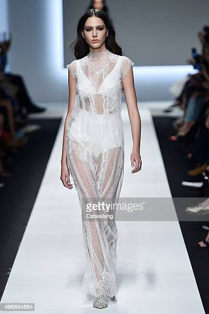 Wearing the latest lacey fabric trend a model walks the Ermanno Scervino fashion show runway at the spring summer 2016 women's readytowear fashion...