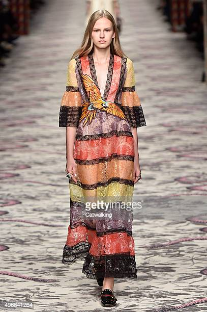 Wearing the latest lacey fabric trend a model walks the Gucci fashion show runway at the spring summer 2016 women's readytowear fashion weeks during...