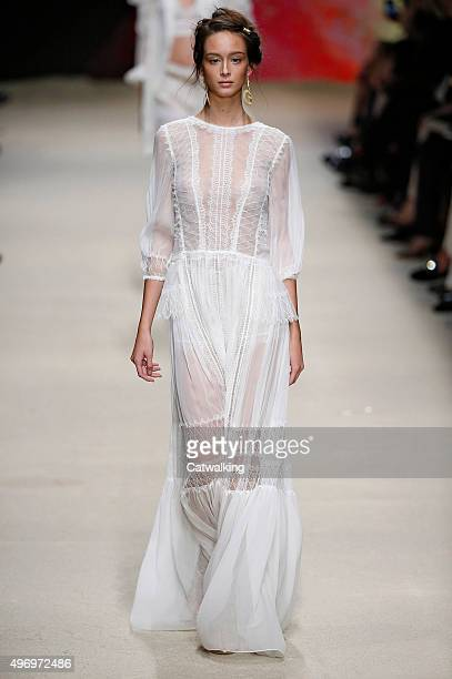 Wearing the latest slip lingerie trend a model walks the Alberta Ferretti fashion show runway at the spring summer 2016 women's readytowear fashion...
