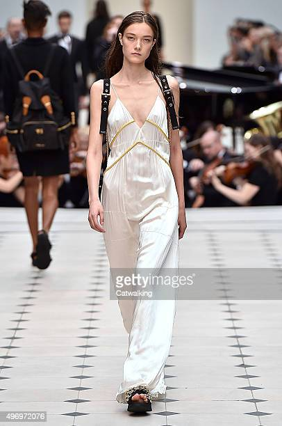 Wearing the latest slip lingerie trend a model walks the Burberry Prorsum fashion show runway at the spring summer 2016 women's readytowear fashion...