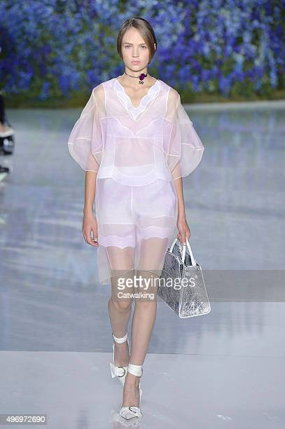 Wearing the latest slip lingerie trend a model walks the Dior fashion show runway at the spring summer 2016 women's readytowear fashion weeks during...