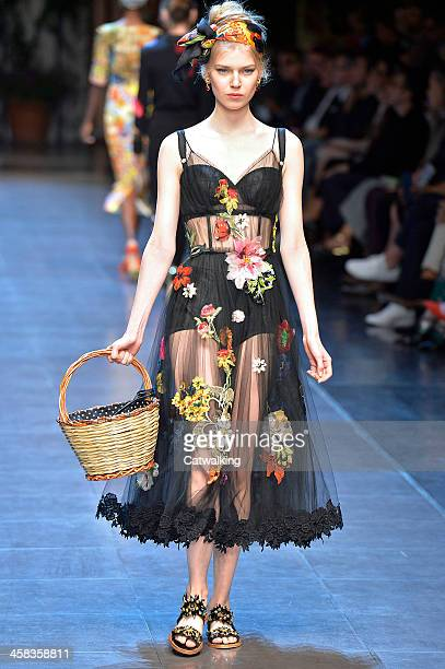 Wearing the latest slip lingerie trend a model walks the Dolce Gabbana fashion show runway at the spring summer 2016 women's readytowear fashion...