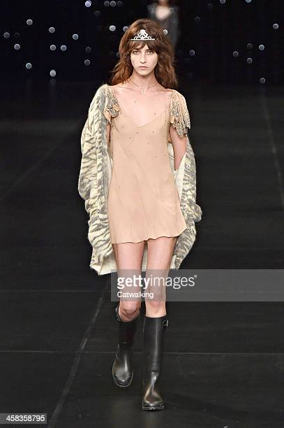 Wearing the latest slip lingerie trend a model walks the Saint Laurent fashion show runway at the spring summer 2016 women's readytowear fashion...