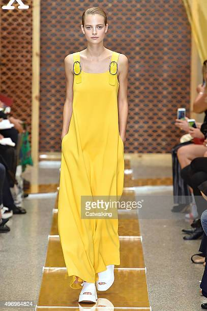 Wearing the latest yellow color trend a model walks the Sportmax fashion show runway at the spring summer 2016 women's readytowear fashion weeks...