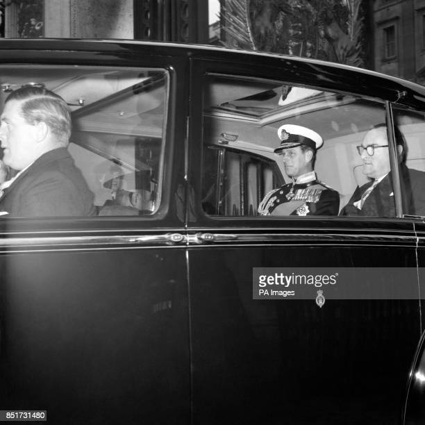 Wearing the uniform of an Admiral of the Fleet Prince Philip The Duke of Edinburgh leaves Buckingham Palace by car to attend with the Duke and...