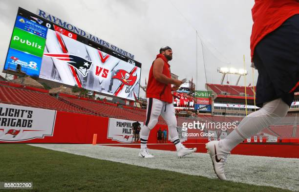 Wearing the white pants that the Patriots are going to be wearing for the Thursday Night Football 'Color Rush' New England Patriots fullback James...