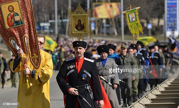 Wearing their traditional costumes Cossacks take part in religious proseccion of Russian Orthodox believers to mark the arrival the icon of slain...