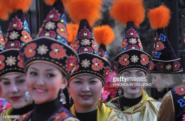 Wearing their traditional costumes Kyrgyz girls dance at the AlaToo Square in Bishkek on March 21 2012 during the annual celebration of Newroz...
