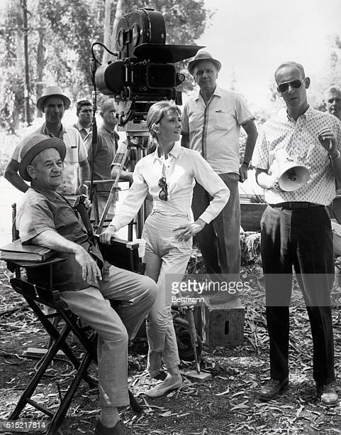 2/24/62 Wearing what practically amounts to a uniform for her actress Audrey Hepburn enjoys a busman's holiday on the set of United Artists' The...