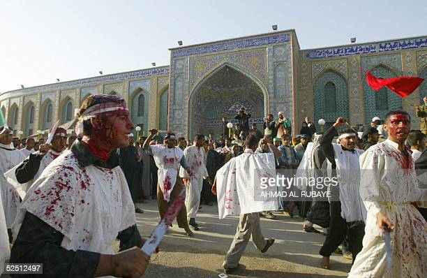 Wearing white shrouds Shiite Muslim pilgrims take part in self flagellation during lamentation ceremonies in the southern city of Karbala marking the...