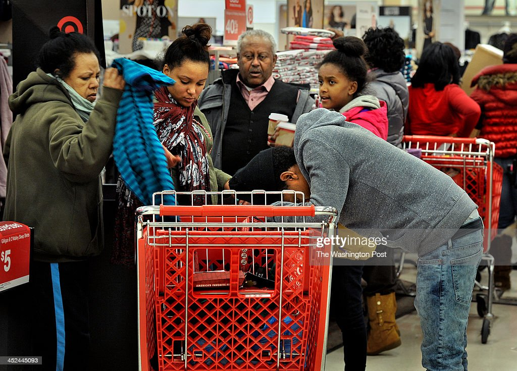 A weary 18-year-old Steve Tefru of Silver Spring hangs his head as he leans and rests on a shopping cart as members of his family go through items looking for low prices. He said he just came along with the family and wasn't shopping for anything for himself. The Target department store in Columbia Heights opened its doors at 8:00pm tonight and hundreds of shoppers were already in line well before that opening time. Many were hoping to get large TV's and other electronics that were being sold at a discount.