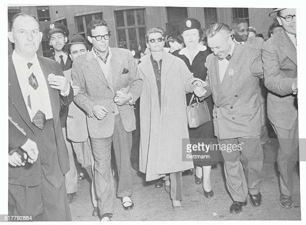 A Weary Rita After Custody Battle White Plains NY Supported by her exhusbands Orson Welles and Prince Aly Khan overwrought Rita Hayworth today...