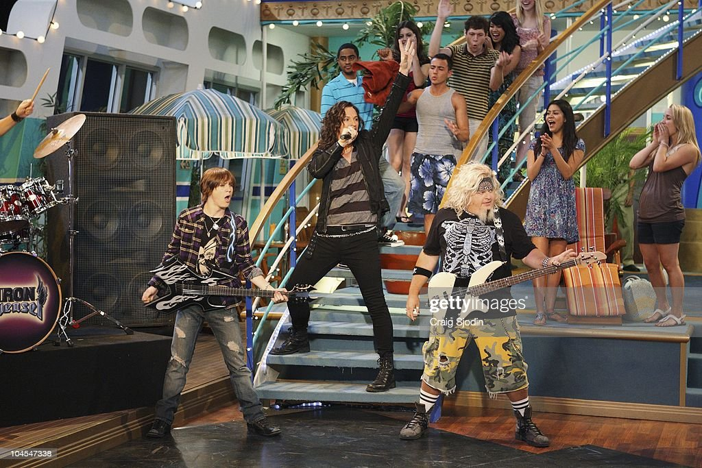 I'M IN THE BAND - 'Weasels on Deck' - Iron Weasel sets out to board the SS Tipton to perform for Mr. Tipton, in hopes of booking a gig at one of his many concert arenas. After Ash's connection to his old friend Moseby falls through, the Weasels must get creative in order to pass security and board the ship. They pose as a touring circus act, Krazy Kouriskazi Brothers, but when word gets out that the real Kouriskazis are a gang of robbers, the Weasels are on the run. With the help of their fans Zack and Cody, Iron Weasel is cleared of the crime, and are able to sneak in a special performance for Mr. Tipton. However in doing so, the guys accidentally create a diversion, and the real Kouriskazis plunder all of the passenger cabins, leading Tripp and the gang to jump ship, in a new episode of 'I'm In The Band' premiering MONDAY, OCTOBER 11 (8:00 p.m., ET/PT) on Disney XD. (Photo by Craig Sjodin/Disney XD via Getty Images) LOGAN