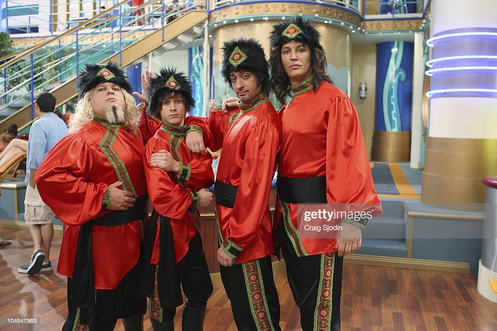 I'M IN THE BAND - 'Weasels on Deck' - Iron Weasel sets out to board the SS Tipton to perform for Mr. Tipton, in hopes of booking a gig at one of his many concert arenas. After Ash's connection to his old friend Moseby falls through, the Weasels must get creative in order to pass security and board the ship. They pose as a touring circus act, Krazy Kouriskazi Brothers, but when word gets out that the real Kouriskazis are a gang of robbers, the Weasels are on the run. With the help of their fans Zack and Cody, Iron Weasel is cleared of the crime, and are able to sneak in a special performance for Mr. Tipton. However in doing so, the guys accidentally create a diversion, and the real Kouriskazis plunder all of the passenger cabins, leading Tripp and the gang to jump ship, in a new episode of 'I'm In The Band' premiering MONDAY, OCTOBER 11 (8:00 p.m., ET/PT) on Disney XD. (Photo by Craig Sjodin/Disney XD via Getty Images) GREGG