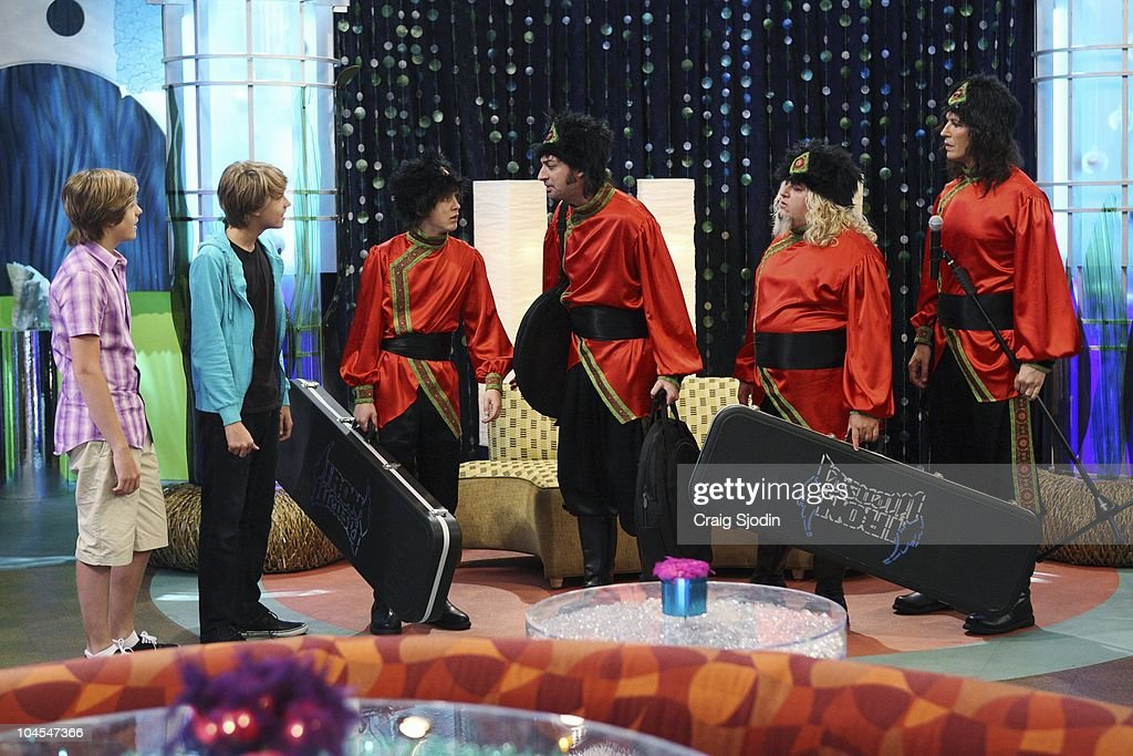 I'M IN THE BAND - 'Weasels on Deck' - Iron Weasel sets out to board the SS Tipton to perform for Mr. Tipton, in hopes of booking a gig at one of his many concert arenas. After Ash's connection to his old friend Moseby falls through, the Weasels must get creative in order to pass security and board the ship. They pose as a touring circus act, Krazy Kouriskazi Brothers, but when word gets out that the real Kouriskazis are a gang of robbers, the Weasels are on the run. With the help of their fans Zack and Cody, Iron Weasel is cleared of the crime, and are able to sneak in a special performance for Mr. Tipton. However in doing so, the guys accidentally create a diversion, and the real Kouriskazis plunder all of the passenger cabins, leading Tripp and the gang to jump ship, in a new episode of 'I'm In The Band' premiering MONDAY, OCTOBER 11 (8:00 p.m., ET/PT) on Disney XD. (Photo by Craig Sjodin/Disney XD via Getty Images) DYLAN