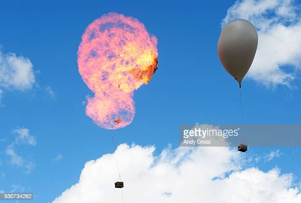 A weather balloon filled with hydrogen is remotely blown up for an egg drop competition at the annual Weather and Science Day at Coors Field May 11...