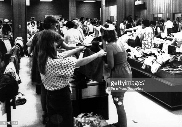 28th December 1974 Sydney Airport's international terminal takes on the appearance of a market as heaps of donated clothing awaits the refugees from...